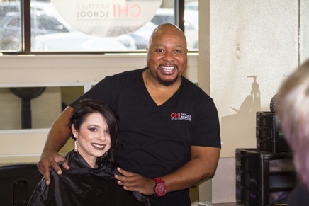 Christopher Andry, Hill College cosmetology program coordinator and instructor, with student.
