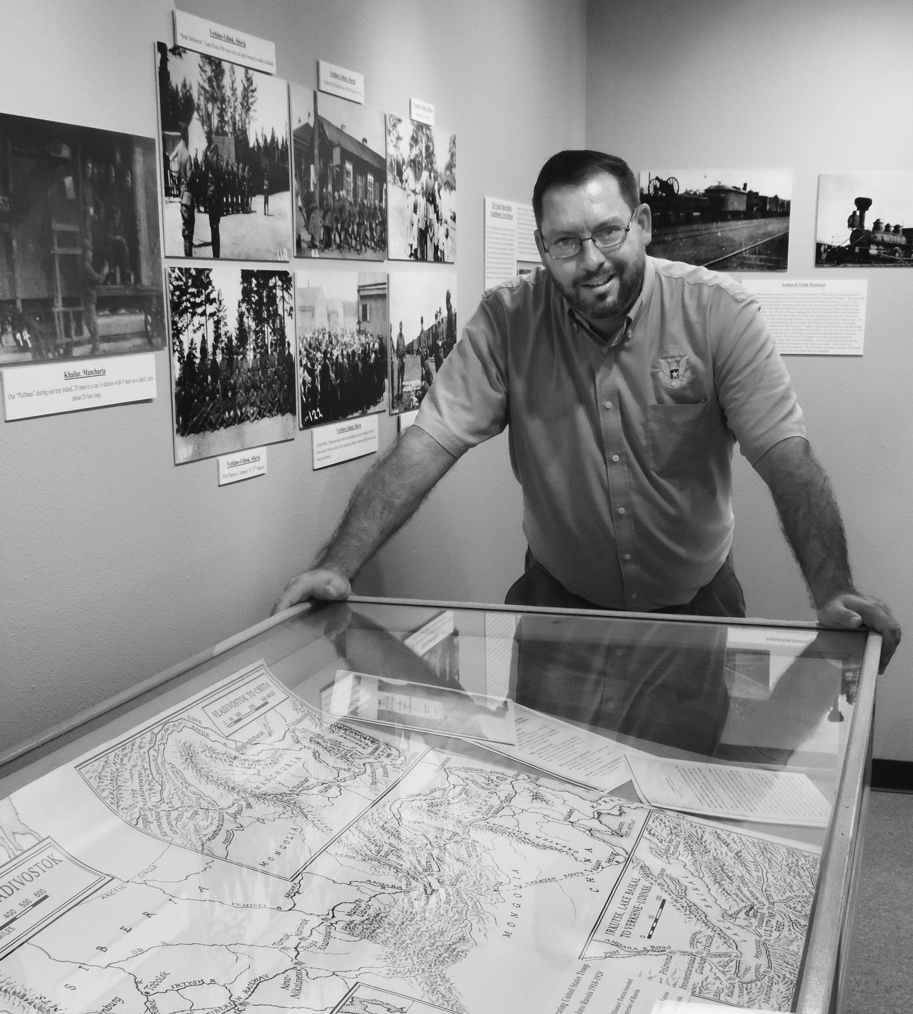 "John Versluis, dean of the Texas Heritage Museum in Hillsboro, looks over a map of Russia, which is a centerpiece for the museum's newest exhibit: ""The Forgotten War: United States Siberia and North Russia Expeditionary Forces 1918-1920."" The special exhibit opens September 23."