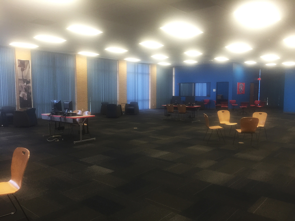 The top level of the library has been replaced with tables, chairs, mini computer stations, a coffee bar and four conference rooms.